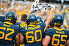 Zach Davis, Noah Drummond, and Donavan Beaver cheer from the sidelines with the rest ofWVU football team faced off against James Madison on August 31, 2019. (WVU Photo/Parker Sheppard)