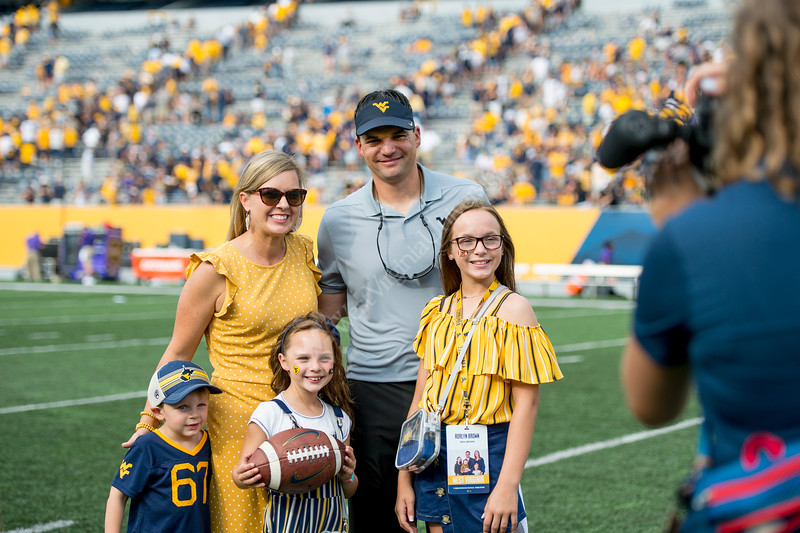 Neal Brown and the Brown family pose for a picture. WVU football team faced off against James Madison on August 31, 2019. (WVU Photo/Parker Sheppard)