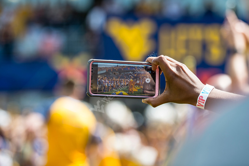 Spectator videos as the Mountaineers prepare to take the field. WVU football team faced off against James Madison on August 31, 2019. (WVU Photo/Parker Sheppard)