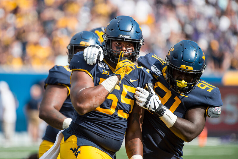 Dante Stills celebrates after making a good tackle. WVU's football team faced off against James Madison on August 31, 2019. (WVU Photo/Parker Sheppard)