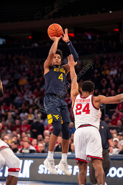 Miles McBride jumps to take a shot. The WVU Men's Basketball team took on Saint John's at Madison Square Garden December 7, 2019. (WVU Photo/Parker Sheppard)