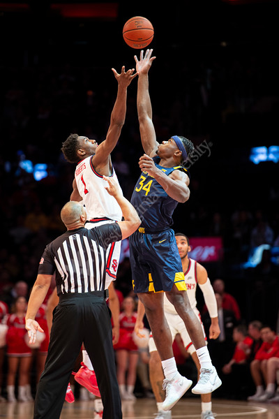 Oscar Tshiebwe jumps for the tip off. The WVU Men's Basketball team took on Saint John's at Madison Square Garden December 7, 2019. (WVU Photo/Parker Sheppard)