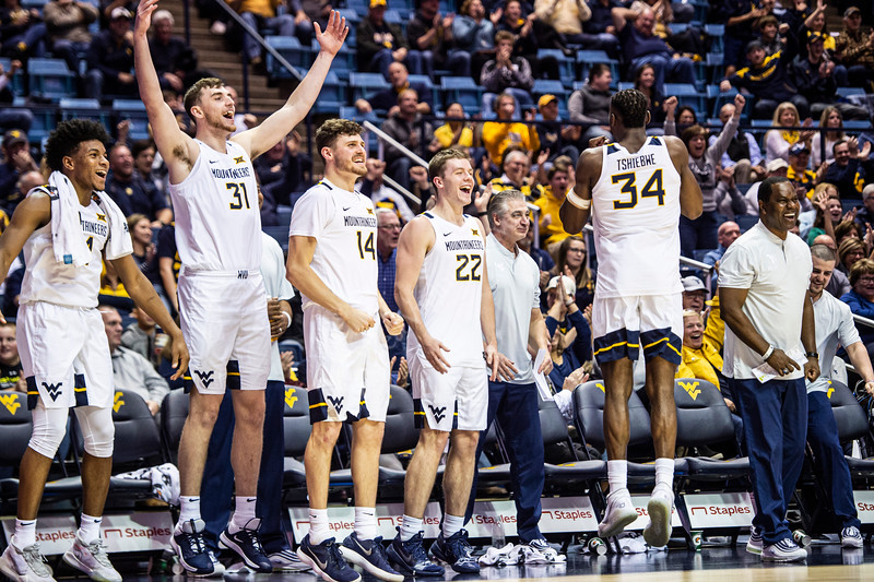 The bench celebrates during the game. WVU Men's Basketball took on Nicholls on December 14, 2019 in the Coliseum. (WVU Photo/Parker Sheppard)