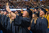WVU graduate Ruth Ann Deely makes a selfie while she sings Country Roads with other graduates at the WVU December Commencement December 21, 2019. (WVU Photo/Greg Ellis)