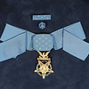 36319 Medal of Honor<br /> Thomas Bennett's medal of honor at WVU Libraries.<br /> WVU Photo/ Raymond Thompson<br /> WVU Magazine