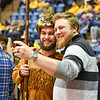 Mascot finalist Connor Capron poses for a selfie with a fan during the second half of the WVU men's basketball game against K-State.