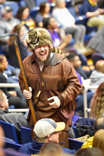Mascot finalist Thaiddeus Dillie shares a laugh with fans during the second half of the WVU men's basketball game against K-State.