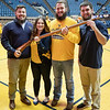 Thaiddues Dillie, Brooke Ashby, Timothy Eads and Connor Capron hold the Mountianeer's rifle before the Mountaineer Mascot cheer off.