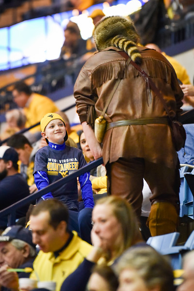 Mascot finalist Timothy Eads chats to a young fan during the first half of the WVU men's basketball game against K-State.