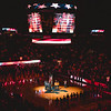 Fans, players and staff watch on as the national anthem is performed ahead of the men's basketball game against K-State.