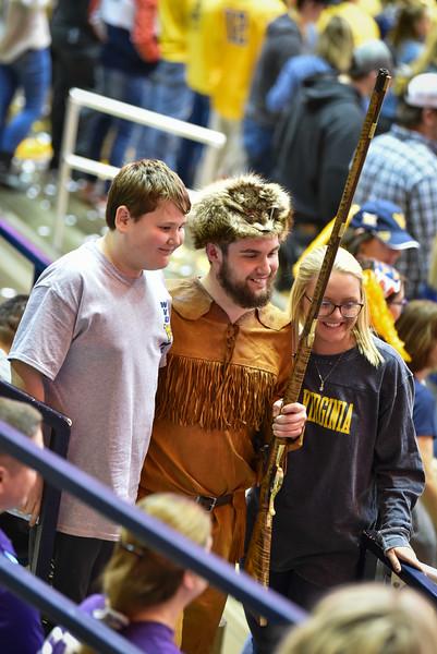 Mascot finalist Connor Capron poses for a photo with a fans during the second half of the WVU men's basketball game against K-State.