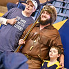 Mascot finalist Timothy Eads poses for a photo with fans during the first half of the WVU men's basketball game against K-State.