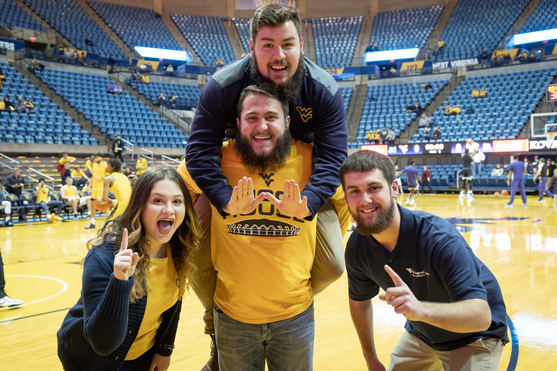 The four Mountaineer Mascots (left to right) Brooke Ashby, Thaiddues Dillie (top) Timothy Eads and Connor Capron pose before the game.