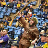 "Mascot finalist Timothy Eads rallies the fans with a ""let's go"" chant during the first half of the WVU men's basketball game against K-State."