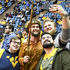 Mascot finalist Connor Capron poses for a photo with fans during the second half of the WVU men's basketball game against K-State.