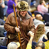 Mascot finalist Thaiddeus Dillie gets a fist bump during the second half of the WVU men's basketball game against K-State.