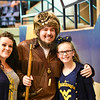 Mascot finalist Thaiddeus Dillie poses for a photo with fans during the second half of the WVU men's basketball game against K-State.