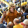 Mascot finalist Brooke Ashby shares high five with a fan during the first half of the WVU men's basketball game against K-State.