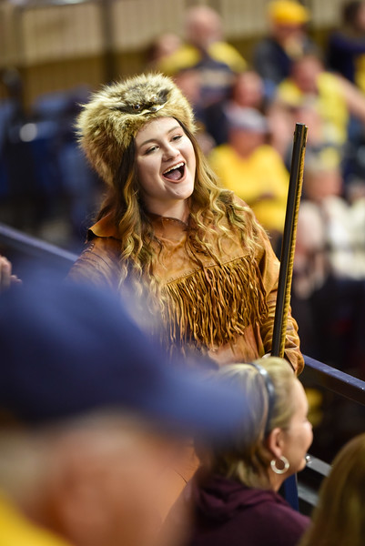 Mascot finalist Brooke Ashby shares a laugh with fans during the first half of the WVU men's basketball game against K-State.