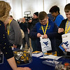 Students get their career pathways buttons at WVU's Day at the Legislature.
