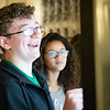 A student laughs while playing a game on a touchscreen at WVU's Day at the Legislature.