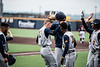 Kevin Brophy and the team celebrating after his home run in WVU's third game of the NCAA Regional on June 2, 2019 at Monongalia County Ballpark. Photo Parker Sheppard