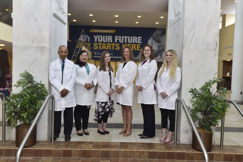 SOM Providers from the Cancer Center Gyn Oncology pose for photographs at the Health Sciences Center Pylons June 25th, 2019.  Photo Brian Persinger