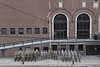 """ROTC Cadets lower the U.S. flag and """"retire the colors"""" for the final time in front of Stansbury Hall during a brief and reserved ceremony in front of the historic brick building along Beechurst Avenue March 8th, 2019.  Photo Brian Persinger"""