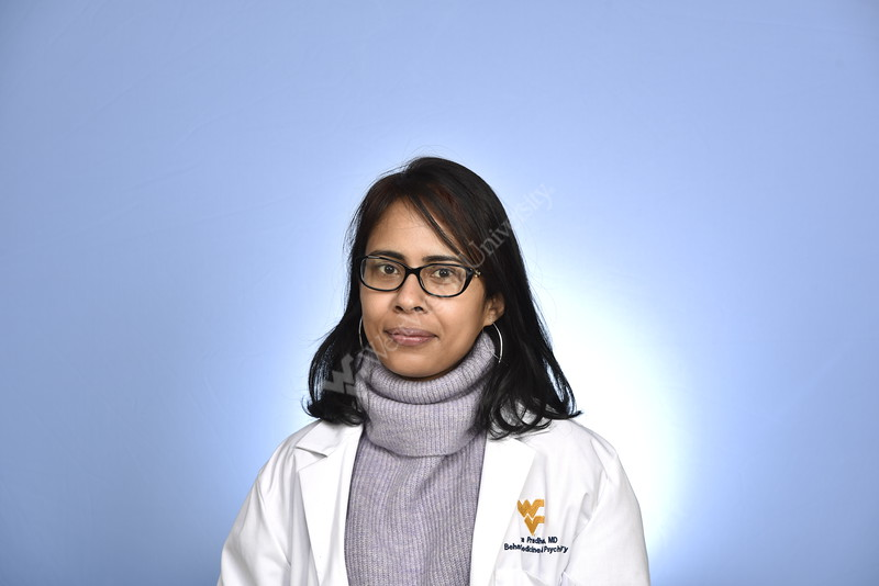Tanya Pradhan WVU Medicine Behavioral Medicine poses for a portrait at the HSC studio March 26, 2019. Photo Greg Ellis