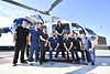 Members of the WVU Medicine Emergency program pose with the WVU Air Methods Helo May 2, 2019. Photo Greg Ellis