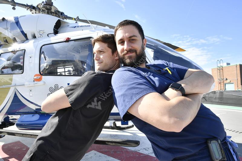 Members of the WVU Medicine Emergency program pose with the WVU Air Methods Helo May 2, 2019. Photo Greg Ellis