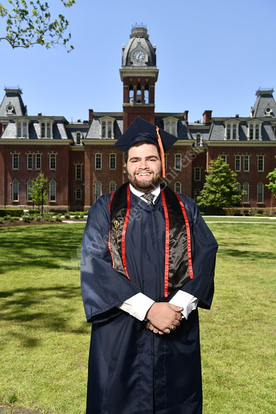 WVU May Graduates pose for pictures at Woodburn Circle with their Cap and Gown May 8, 2019. Photo Greg Ellis