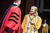 Ginny Thrasher walks across the stage and talks with Acting Dean of the Honors College Ryan Claycomb during the Medallion Ceremony at the CAC May 9th, 2019.  Photo Brian Persinger