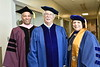 WVU Alumni Jay Chattaway receives an HDOC from WVU Provost Joyce McConnell and CAC Dean Keith Jackson at the CAC May Commencement May 10, 2019. Photo Greg Ellis