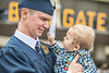 William Burgess, a graudate in the department of Multi Disciplinary Studies poses for family photos with his son Brennex after the Eberly College of Arts and Sciences Undergraduate Commencement at the Coliseum May 12th, 2019.  Photo Brian Persinger