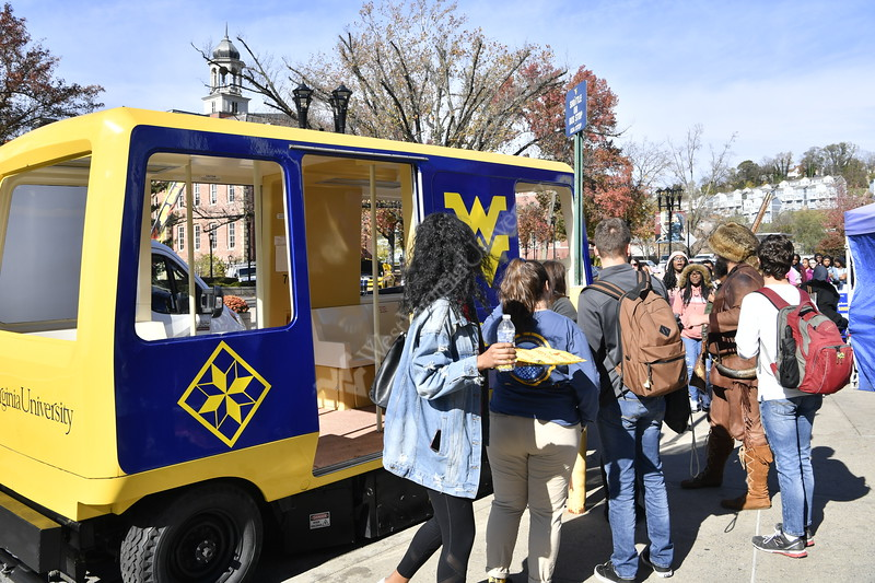 The WVU Mountianeer , WVU students, staff and Middle School students from Warrensville Heights Middle School Warrensville, OH set the Mountaineer Week 2019 PRT Cram record at 51 people, beating the WVU SGA by 20. The student from Warrensville were on a tour of WV Colleges and Universities. November 4, 2019. (WVU Photo/Greg Ellis)