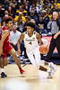 Miles McBride dribbling past a defender. The WVU Men's Basketball team took on Boston University at the Coliseum November 22, 2019. (WVU Photo/Parker Sheppard)