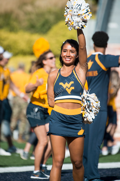 Cheerleader performs for the crowd. WVU Football faced off against Texas at Mountaineer Field October 5, 2019. (WVU Photo/Parker Sheppard)