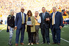 Dr. Patrice Harris recieves an award during the Homecoming Alumni Awards given out at half time during the WVU Football game against Texas on October 5, 2019. (WVU Photo/Parker Sheppard)