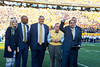 Dr. Joshua Mali recieves an award during the Homecoming Alumni Awards given out at half time during the WVU Football game against Texas on October 5, 2019. (WVU Photo/Parker Sheppard)