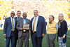 Dr. Dana Brooks recieves an award during the Homecoming Alumni Awards given out at half time during the WVU Football game against Texas on October 5, 2019. (WVU Photo/Parker Sheppard)