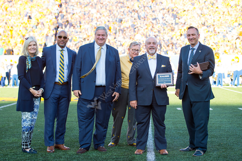 Dr. Norman D. Ferrari recieves an award during the Homecoming Alumni Awards given out at half time during the WVU Football game against Texas on October 5, 2019. (WVU Photo/Parker Sheppard)