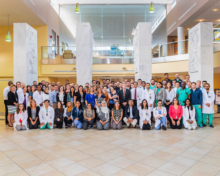 Members of the WVU School Of Medicine pose for a group photo at the Pylons, HSC September 6, 2019. (WVU Photo/Greg Ellis)