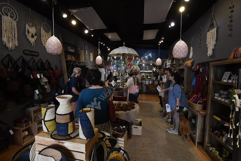 River Fair Trade shop owner Shannon Dowling speaks to MDS students about how fair trade items are defined and how sustainability is related to climate change at her shop on High Street September 19th, 2019.   (WVU Photo/Brian Persinger)
