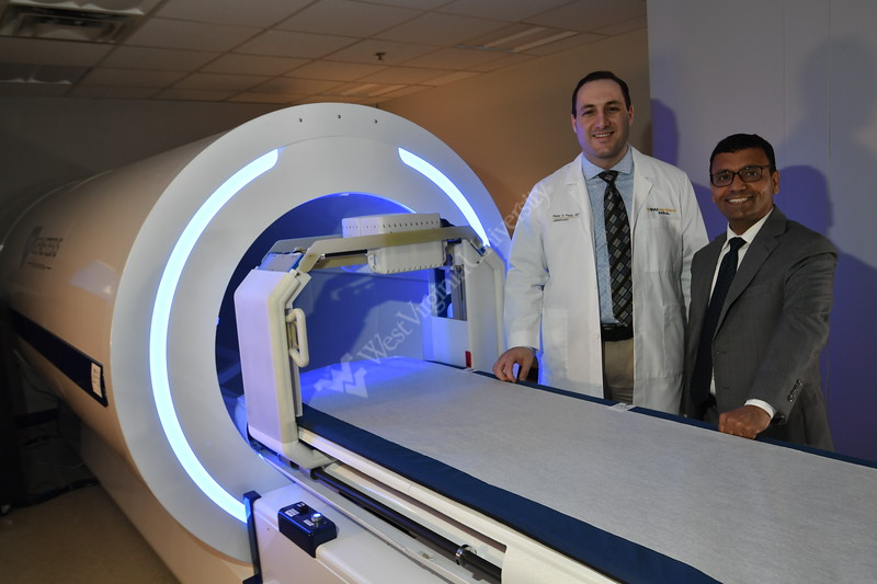 Dr. Peter Farjo and Dr. Partho Sengupta pose with equipment used in Genetesis Research used in clinical trials related to Heart Disease. (WVU Photo/Greg Ellis)