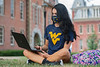 WVU Freshmen Haley Miller Psychology St. Albans WV. studies on her laptop at Woodburn Circle on the Downtown WVU Campus as students return to the WVU Campus for the first day of classes during the Covid-19 pandemic August 26, 2020. (WVU Photo/Greg Ellis)