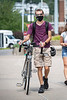 WVU Freshmen Noha Hower Mechanical Engineering, Shippensburg Pa. walks his bike on the Downtown campus as students return to the WVU Campus for the first day of classes during the Covid-19 pandemic August 26, 2020. (WVU Photo/Greg Ellis)