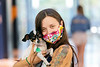 WVU Freshmen Cassidy Wetz poses for pics with her dog Sissy at the WVU Mountainlair as freshmen students return to the WVU campus interacting and physical distancing before the start of classes during the Covid-19 pandemic August 19, 2020. (WVU Photo/Greg Ellis)