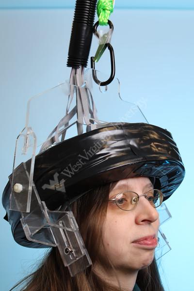 36338 Pet Helmet<br /> Julie Brefczynskik-Lewis wears an experimental potable PET helmet.<br /> WVU Photo/ Raymond Thompson
