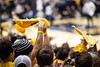 Fans twirl towels in the air. WVU Men's Basketball took on Kansas on February 13, 2020 in the Coliseum. (WVU Photo/Parker Sheppard)